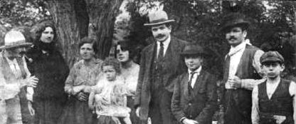 http://www.patrus53.com/wp-content/uploads/2011/12/002-The-Reinhardt-family-1920-N%C3%A9gros-second-from-left-and-Django-third-from-right-This-is-the-earliest-known-photograph-of-Django-Reinhardt.jpg